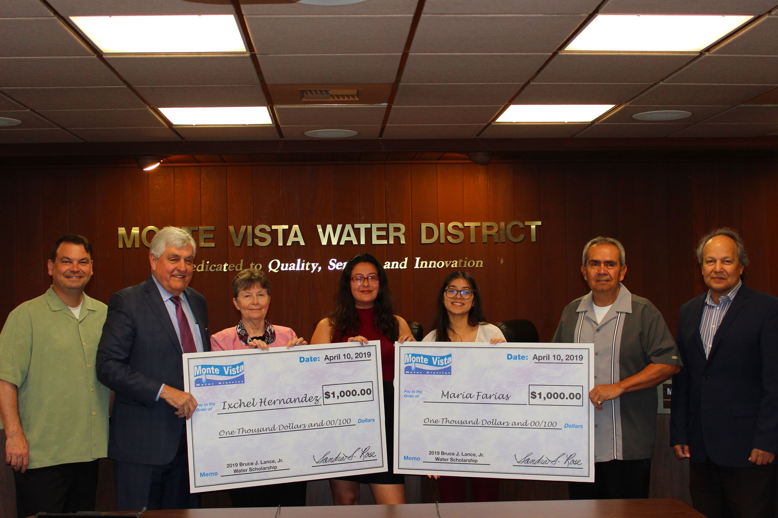 Scholarship winners pose with members of MVWD's Board of Directors after being presented with cer